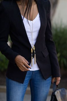 A simple yet, chic look! Try a plain white t-shirt with your go-to black blazer. Add chunky gold jewelry for night out.