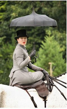 Frampton-on-Severn Country Show. She was riding out with the Tent-Pegging teams. side saddle with a parasol on a grey horse, too much fabulousity for me Equestrian Boots, Equestrian Outfits, Equestrian Style, Equestrian Fashion, Horse Caballo, Riding Habit, Side Saddle, Foto Fashion, Parasols