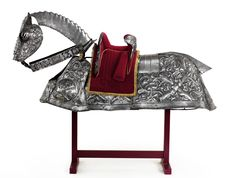 Horse armour made for Henry VIII    The suit of armour is decorated with Katherine's pomegranates and also has a border of intertwined letters H and K for Henry and Katherine. The armour also features scenes from the lives of the royal couple's patron saints, St George and St Barbara.