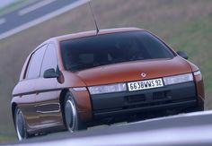 """On 18 June 1995, Renault introduced NEXT, a completely revolutionary concept car: a family hybrid vehicle with a conventional engine in the front and two electric motor-wheels at the back. It could reach a top speed of 165kph. NEXT was the creation of the """"Exploratory Vehicles Unit"""", which was run at the time by Rémi Deconinck. We look back at the unit's achievement. More information on our blog: http://blog.renault.com/en/?p=1947 (c) Renault Communication - Droits réservés Renault"""