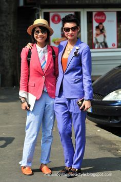 I love how Esther Quek (right) feminizes the menswear look with a low tank and statement necklace. Lovely!!