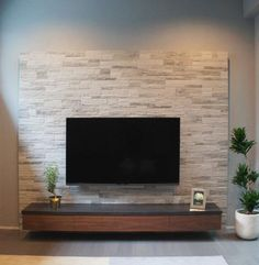 """TV mounted on wall + electronics below - want storage in black and smaller (width of 60"""" tv)"""