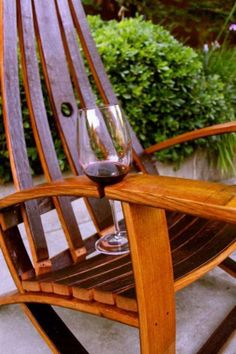 Adirondeck Chair w/ wine glass holder on arm made from a wine barrel.  Available via http://www.bythebarrelmn.com/Rain_Barrels_And_Planters.html
