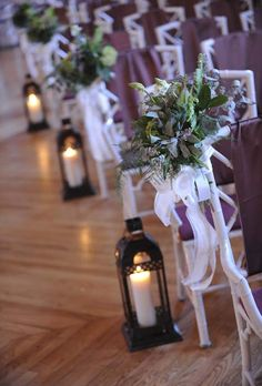 Lanterns with lit pillar candles create an elegant Wedding aisle at this Asheville Wedding