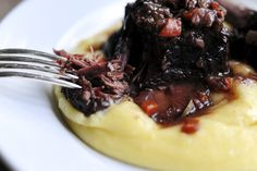 Pioneer Woman's braised short ribs over creamy polenta with goat cheese...oh my heaven.  I'm trying this ASAP.