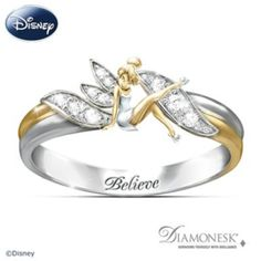"Solid sterling silver with 18K-gold plating, engraved with ""Believe."" Diamonesk® stones embrace Tinker Bell and light up her wings. Gift box."