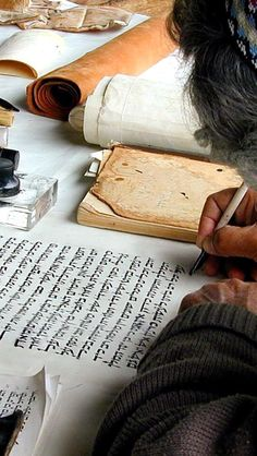 Scribe writing Hebrew scriptures, land of Israel.