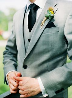 Men's 3 pc soft aqua suit, dark green buttons, hunter green tie & lapel scarf, white shirt, accented w/ yellow boutonniere.