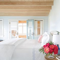 Soft Escape - 30 Beautiful Beachy Bedrooms - Coastal Living Soft Escape Cypress ceilings and shiplap walls painted soft seafoam lend a breezy feel to this Jersey Shore bedroom.  Idea Spotlight Bedding embroidered with a fun shade is an easy and subtle way to incorporate color into an otherwise neutral room.