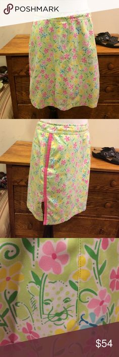 Lilly Pulitzer Skort size 6 Lilly Pulitzer Skort size 6.  Super soft adjustable waist skort.  Side pockets & rear pocket still sewn shut.  Beautiful like new condition.  Flowers, butterfly's and cats. Lilly Pulitzer Shorts Skorts