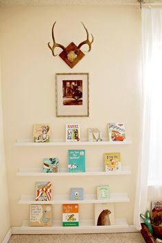Love the rustic touches to this library wall in the nursery