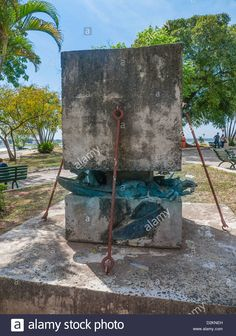 Stock Photo - A famous Alfredo Stroessner sculpture with pieces of a older bronze statue of the ex-dictator crushed by huge pieces of concrete Public Art, Concrete, Vectors, Bronze, Icons, America, Stock Photos, Illustrations, Sculpture