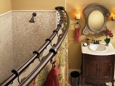 I would love to have double curved shower rods in the bathrooms.  Double curtains and double liners, split in the middle with tie-backs on each side, so they look like nice curtains. Outside second bar for keeping your towel handy. This bar is Moen's Old world bronze curved shower rod - DN2141OWB