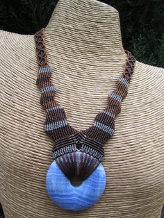 Necklace | Mingui Kelly.  Macrame necklace with blue lace agate donut stone.