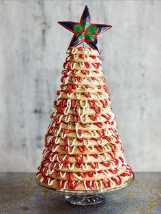 Imagine bringing out this jaw-dropping show stopper at the end of Christmas dinner! Paul Hollywood's Kransekake from The Great British Bake Off: Christmas never fails to delight and makes for a great Christmas dessert.