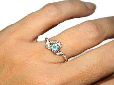 """Thanks for the kind words! ★★★★★ """"It is an absolutely beautiful ring, love Mercury Topaz!"""" Jan http://etsy.me/2E6kiom #etsy #jewelry #ring #rainbow #silver #no #girls #topaz #round #mercurymistring"""