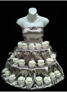 """The Couture Cupcake Stand"" will set you apart and add style and WOW to your event: Bridal showers, quinceaneras, weddings or even a birthday celebration to display your cupcakes for your guests to enjoy.     Allow 3 weeks lead time, (21 days) from date of purchase to receive    Measures Approximately 30"" high x 31"" wide at base  3 tiers: 18"", 24"" and 31"" with supports at each tier  6"" between each tier   Holds 75-100 cupcakes depending on size, cupcakes are displayed all around the dress…"