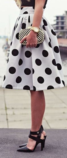 Black crop top, a black and white polka dot skirt, and black heels.