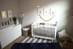 Love the layered rugs and fun gold pops in this baby boy nursery!