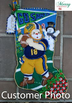 "Customer photo sent to MerryStockings. Bucilla Felt Stocking Kit entitled ""Football Santa"". Customer modified for hometown team - cute!"