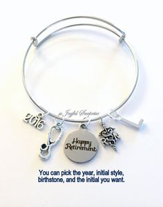 Retirement Gift for Women RN Nurse, 2016 2017 or 2018 Charm Bracelet Jewelry Silver Bangle Coworker Head initial LPN initial Present woman custom Christmas Present  This bracelet listing includes: - a stainless steel silver laser engraved Happy Retirement charm: 3/4 x 7/8 - an antique silver Stethoscope Charm: 7/8 x 3/8 - an antique silver Registered Nurse Symbol charm: 3/4 x 1/2 - an antique silver year charm of your choice (2015,2016,2017,or 2018 more to come) ...