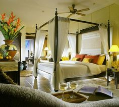 bedroom decorating ideas using iron bed | Solid frame canopy bed with rails for a chic look