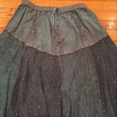 """weekend saleFabulous boho gypsy ruffled skirt Elastic waistband with a faux tie. Layers of eyelet and embroidered designs. The color is slate. 100%rayon. So amazing and fun to wear. Size is """"free size"""" but it has an elastic waist that measures 24 inches when not stretched. Fabulous Skirts Maxi"""