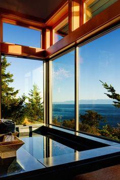 San Juan Cliffside House by Prentiss Architects, San Juan Island, Washington State, US.