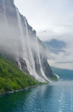 "The Seven Sisters Waterfall in Geiranger Fjord, Norway. Directly across the fjord lies a single waterfall called ""The Suitor"". The legend of the seven sisters is that they dance playfully down the mountain. Meanwhile, across the fjord, the suitor flirts playfully with them from afar."