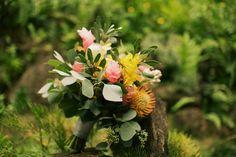 Tropical Hawaii destination wedding bouquet idea - colorful Pincushion Proteas and greenery
