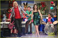 The A & A Music Factory Celebrates Their First Christmas - See The Pics!: Photo #902088. Ally (Laura Marano) and Austin (Ross Lynch) perform a new holiday song for their Music Factory students in this new still from Austin & Ally.    In