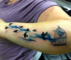 Some watercolor getaway bird silhouettes by @_j_haines #watercolor #watercolortattoo #silhouette #ikonicforareason #birdcage #forearmtattoo #redemptiontattoocare #follow #inklife #tattoos #tattooist by ikonicink_tattoo