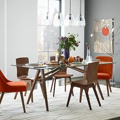 Jensen Dining Table #westelm  Our dining room is very small and I wondered if this kind of table design could help it seem more roomy.  Like the table, not keen on the chairs.