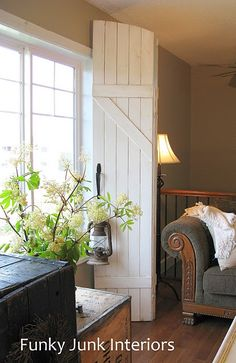 shutters as window treatments! great idea for an alternative window treatment! I have a bay window in my famrm and its a challenge to dress without it looking showy and squat or a hollow shell - I'm thinking old shutters hinged ???