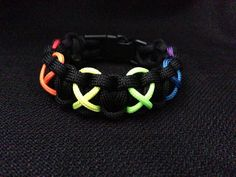 Black with Awareness Ribbons Survival 550 Bracelet with Rainbow Symbols (custom sized) Cobra Weave, Paracord Projects, 550 Paracord, Paracord Bracelets, Awareness Ribbons, Small Gifts, Bracelet Making, Stocking Stuffers, Survival