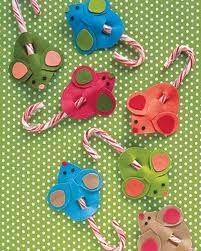 Christmas mice made out of felt and candy canes.  Use craft glue [mum or dad to use] and toddler to chose the colours.  Have them thread through the candy canes.