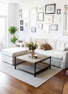 Chic and casual living room with gallery wall and lots of plants