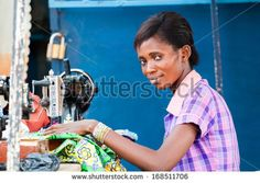 GHANA - MARCH 2, 2012: Unindentified Ghanaian woman works with a sewing machine in Ghana, on March 2nd, 2012. People in Ghana suffer from poverty due to the slow development of the country - stock photo