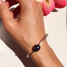 Lifou 'Around you' silver bangles with rose & black freshwater pearls 💕☀️🌊 Magic from the Sea. Silver Bangles, Fresh Water, Belly Button Rings, Magic, Sea, Pearls, Black, Jewelry, Jewlery