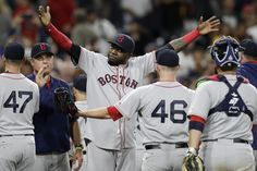 Boston Red Sox designated hitter David Ortiz, center, greets relief pitcher…
