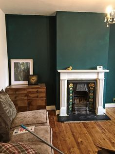 living room flooring How To Use Dark Green in Your Living Room Melanie Jade Design Dark Green Living Room, Dark Living Rooms, Green Rooms, Living Room Paint, Home Living Room, Green Accent Walls, Dark Green Walls, Brown Walls, Living Room Color Schemes
