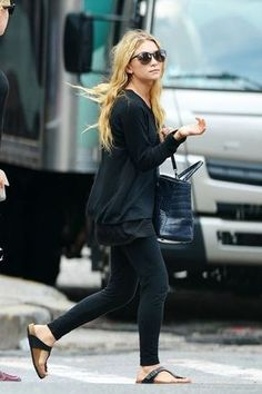 15 Ways To Do New York City Like An Olsen Twin #refinery29 http://www.refinery29.com/olsen-twins-nyc-pictures#slide-8 When: July 2012Where: TribecaKeeping things so, so simple, Ashley parades through downtown Manhattan sporting a black sweater and leggings, a navy crocodile tote bag by The Row, and seriously ugly-cute Birkenstocks. It's casual chic meets complete comfort.