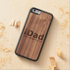 "Unique, fashionable, trendy and cool design. Funny ""iDad there's an app for that"" quote text on real wood carved background plate. This funky, modern and whimsical design was created for the dad with a sense of humor. Great present for Father's day, Christmas, dad's birthday, the new daddy or dad to be."