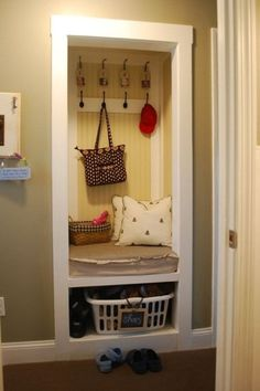 Though we're not quite ready to think about wet, snowy weather, we love how Wendy transformed a simple closet into a rather charming mudroom for her family complete with bench, hooks designated for each child with photographs, and a basket for shoes.