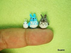"""Tiny Totoros!  These are """"micro amigurumi"""" - miniature crochet animals created by Su Ami, a group of five family members in Vietnam.  """"Each piece is made using a 0.4mm crochet hook and a 0.3mm needle for sewing on the eyes.""""  And yes!  They have an Etsy store: http://su-ami.blogspot.jp/p/etsy-store.html"""