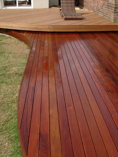 curved deck designs with beautiful colour- could curve it on the side if the house to make room for pots?
