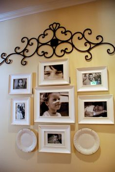 Black and white photos in white frames...I would have chosen black, but I like the white better with the yellow wall.