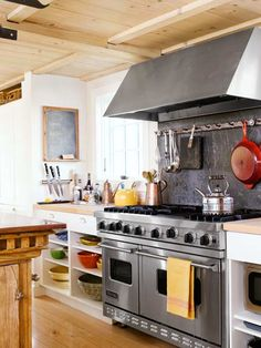 Who says a serious cook can't mix a muscular range and hood into a cottage kitchen? |  Photo: John Gruen | thisoldhouse.com