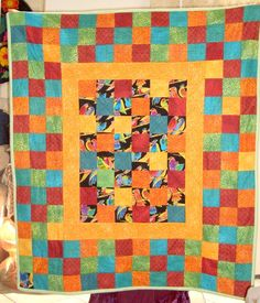 Here is the rest of the Laurel Burch fabric in another flannel baby quilt.