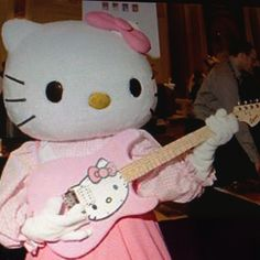 Hello kitty playing the pink hello kitty guitar lol.